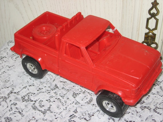 Red Plastic TOOTSIE TOY Pick Up Spare Tire in back of Truck Cool