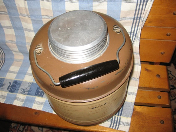 Vintage Camping Thermos with like pottery or ceramic