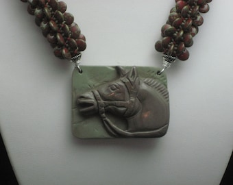 Carved Horse Head In Ribbon Jasper