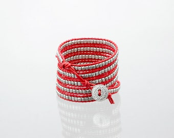 Wrap bracelet with silver beads on red leather