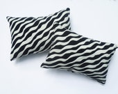 Two Textured Black,Cream Pillows Brings The Wild SIde To Your Room
