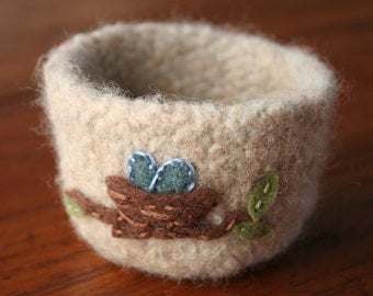 natural wool felted vessel with spring bird nest and eggs