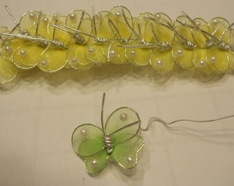 12 yellow mesh butterfly's with bead embellishment, 27 mm wide (R2)