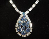 Vintage Blue Rhinestone Necklace.  Chain of Clear Rhinestones Attached to Blue Rhinestone Pendant.