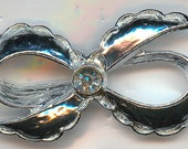 Vintage Bow Brooch, Made By Gerry's.  Silver Tone Bow with a Clear Rhinestone Center