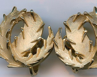 Vintage Trifari Earrings in a floral design. Signed Clip On Style.  In excellent condition.