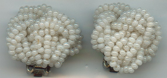 Vintage hand made clip on beaded earrings.  Hundreds of tiny white beads.