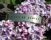 We aim to please Hand Stamped Cuff Quote Bracelet From Fifty Shades of Grey