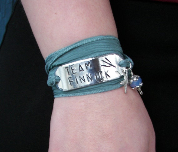 The Hunger Games Bracelet Wrap TEAM FINNICK Hand Stamped with Gray Green Silk Ribbon Wrap