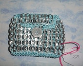 Light blue wallet made with soda can pull tabs
