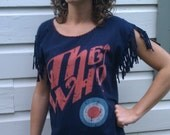 Upcycled Tshirt with hand embroidered collar, hem, and hand knotted sleeves.