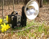Vintage Brownie Hawkeye camera with flash reflector