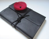 medium black leather journal with black wrap tie and poppy red organza floral embellishment