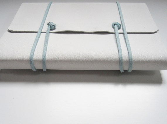 medium white leather journal with blue wrap cord