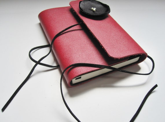 medium red leather journal with black wrap tie and satin flower
