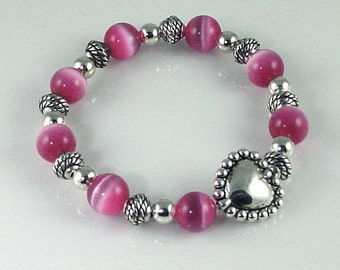 Pink Cats Eye Stretch Bracelet with Silver Heart Bead