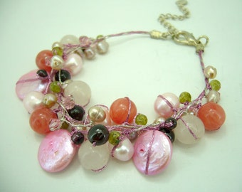 Pink coin freshwater pearl,peridot,garnet hand knotted on silk thread bracelet.