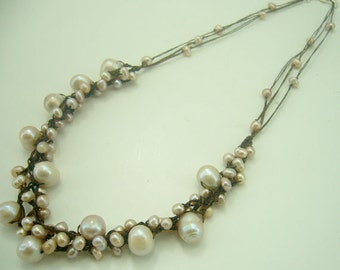 Light ping freshwater pearl hand knotted on wax cotton necklace.