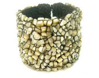 Shell knitting wax cotton bangle.