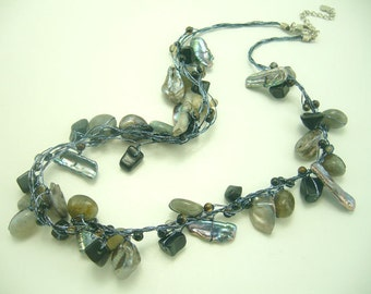 Natural shape freshwater pearl, shell necklace.