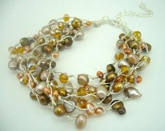 Light peach,grey freshwater pearl silk bracelet.