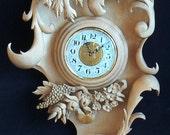 Horloge au mascaron