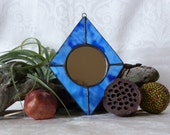 Blue stained glass feng shui mirror