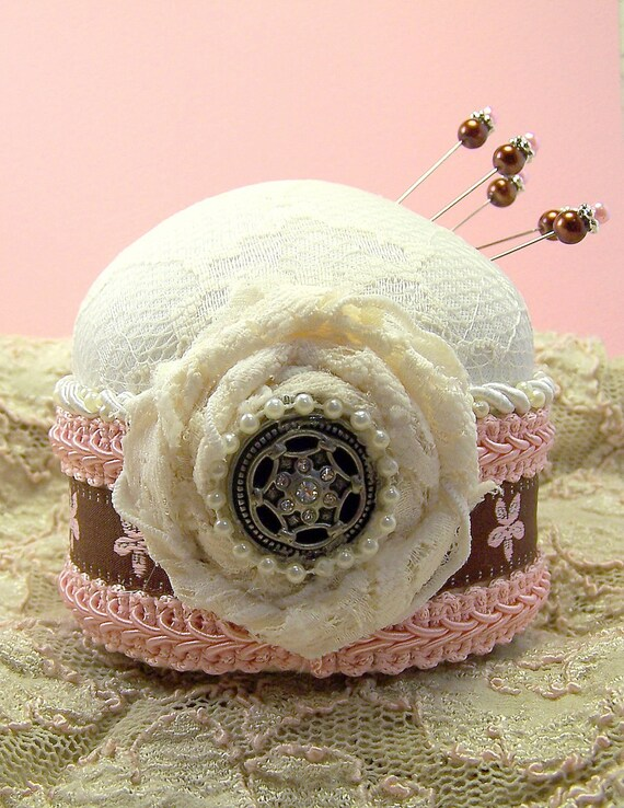 Pink and Sweet Iced Petit Fours Pincushion with ivory lace and pink and brown trim and tack pins