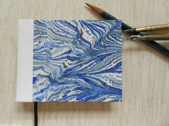 Small Hand made blank book with white leather spine. Blue