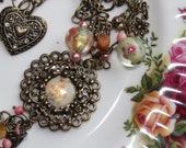 Romantic bronze metal chain and flower pendant necklace, bracelet, and earring set