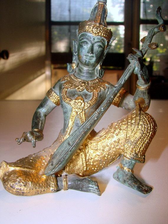 Beautiful Bronzed Goddess Saraswati Figure playing a Bina (veena)