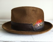 Vintage Penney's Towncraft Brown Corduroy Fedora hat adorned with a feather
