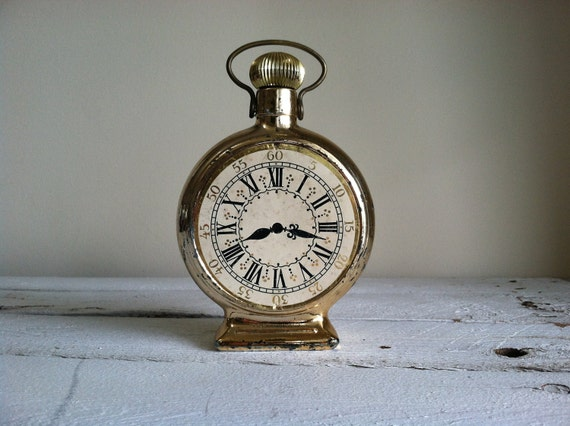 Tick tock vintage in time,  Avon Windjammer aftershave clock bottle for the dapper dude