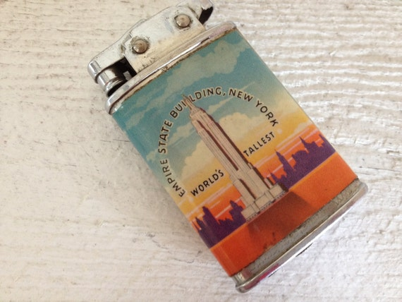 Vintage Empire state building butane Lighter and on the flip side we have the statue of liberty New York FREE SHIPPING