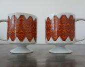 Set of Two Vintage Holt Howard Pedestal Mugs Orange, rust and white