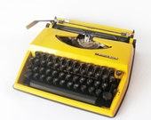 Bright Yellow Triumph Typewriter Tippa Adler - made in Holland - manual retro Typewriter