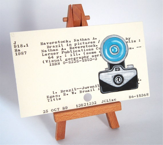Vintage Camera with Flash on Library Card black silver blue camera photography Brazil