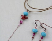 Necklace with faceted turquoise pearl, red jasper and pink crystal