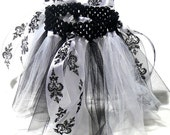 Black and white baby tutu with ribbon details.