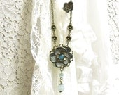 Leather flower necklace Aqua glass beaded antique brass necklace with blue leather flower