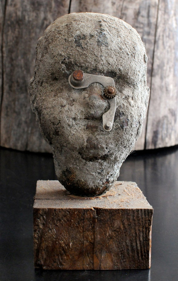 Doll Head Sculpture -- The Bad Monocle