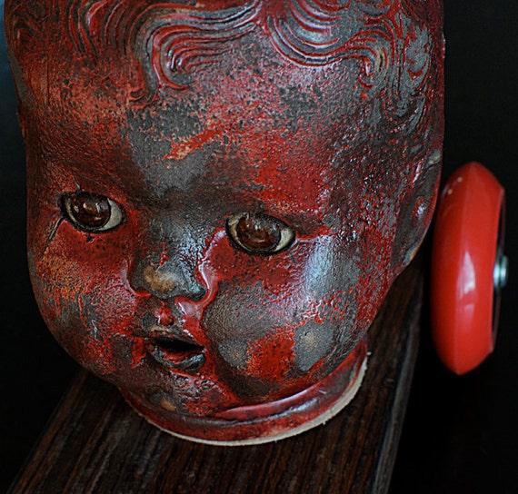Doll Head Sculpture -- The Chauffeur