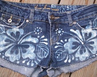 Hot Momma -  Hand bleached Hibiscus Henna design on daisy duke denim shorts