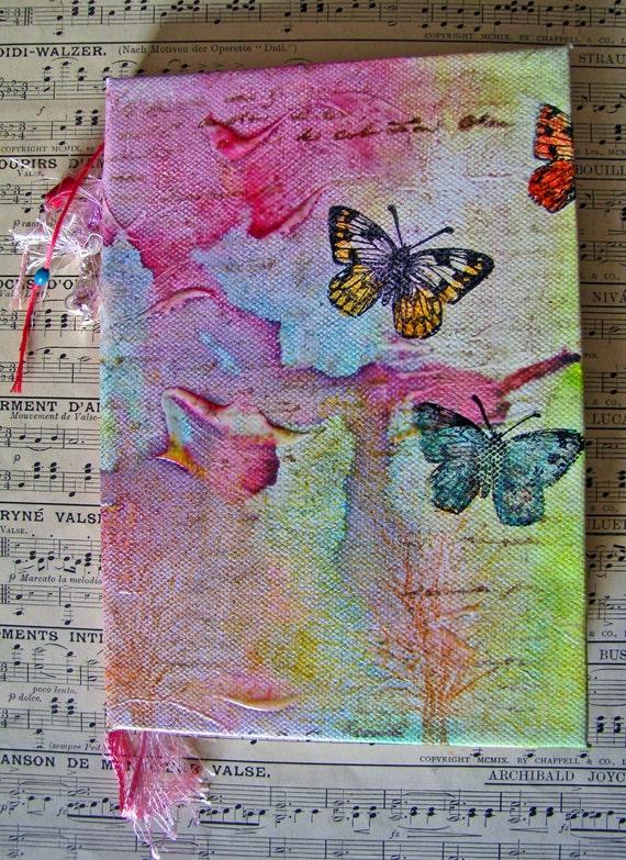 Painted canvas hardcovered  book, journal, notebook, sketchbook  in brighr feminine colors, featuring butterflies