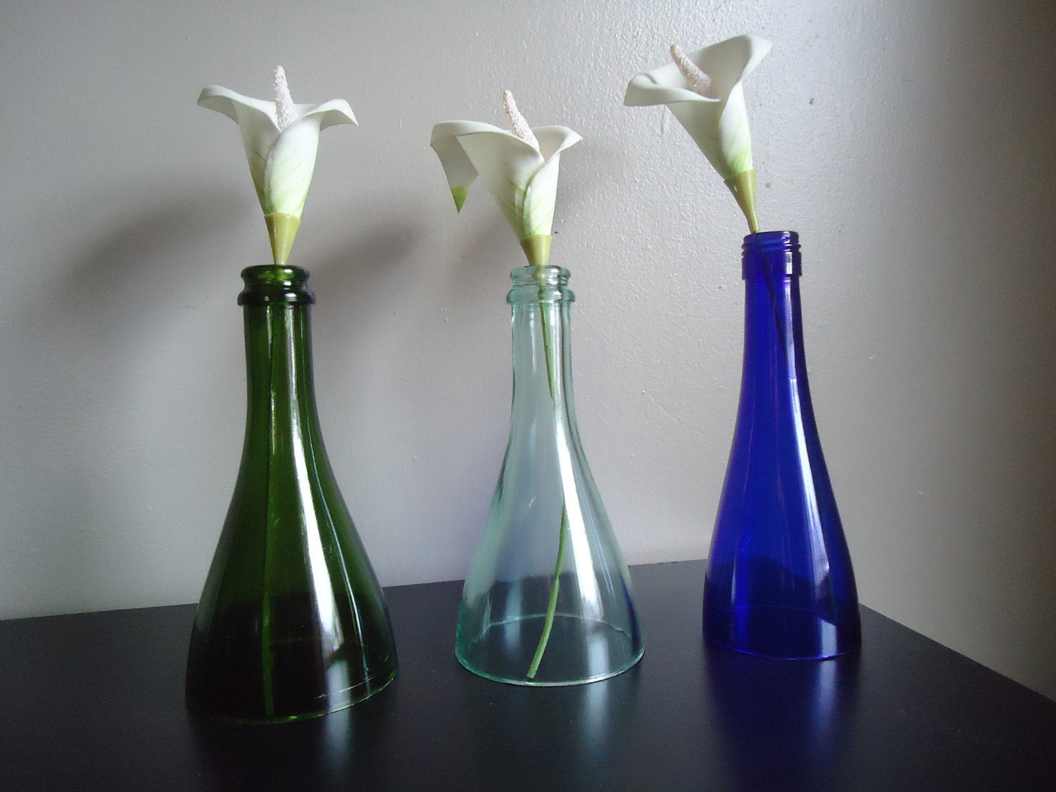 Recycled wine bottle candle holders by tipsycycling on etsy for Champagne bottle candle holders