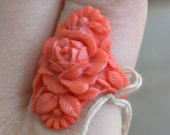 Pretty in pink mint NOS art deco celluloid flower ring
