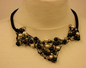 Black wire viking weave choker with green glass beeds and faux pearls