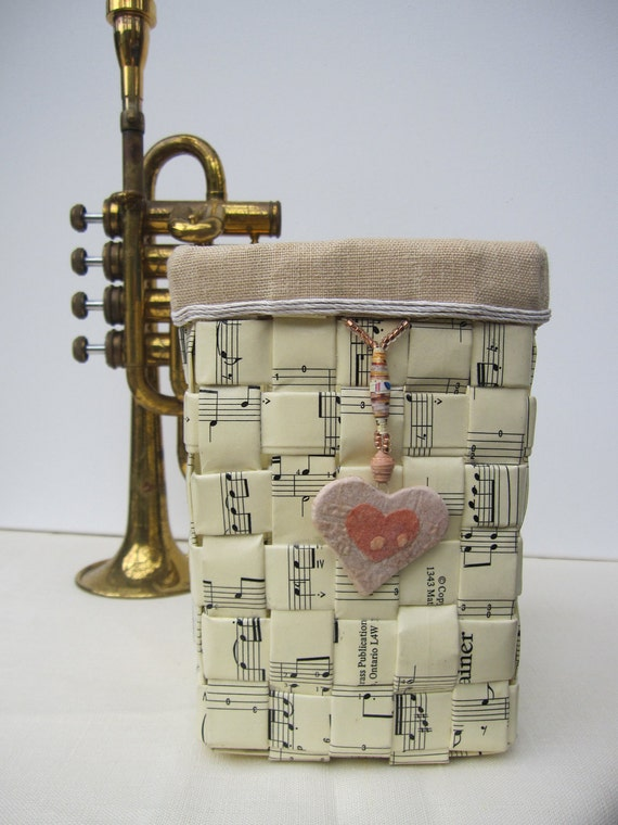 Paper basket handwoven from sheet music