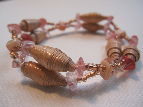 Peach colored bracelet made with paper beads crafted from handmade paper
