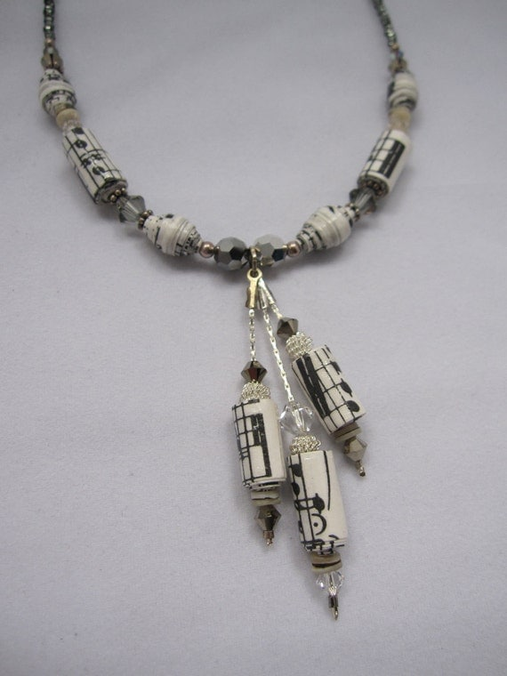 Necklace made with beads crafted from sheet music